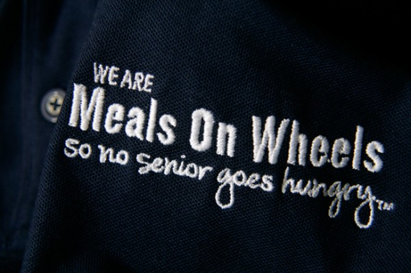 Meals On Wheels logo embroidered in white